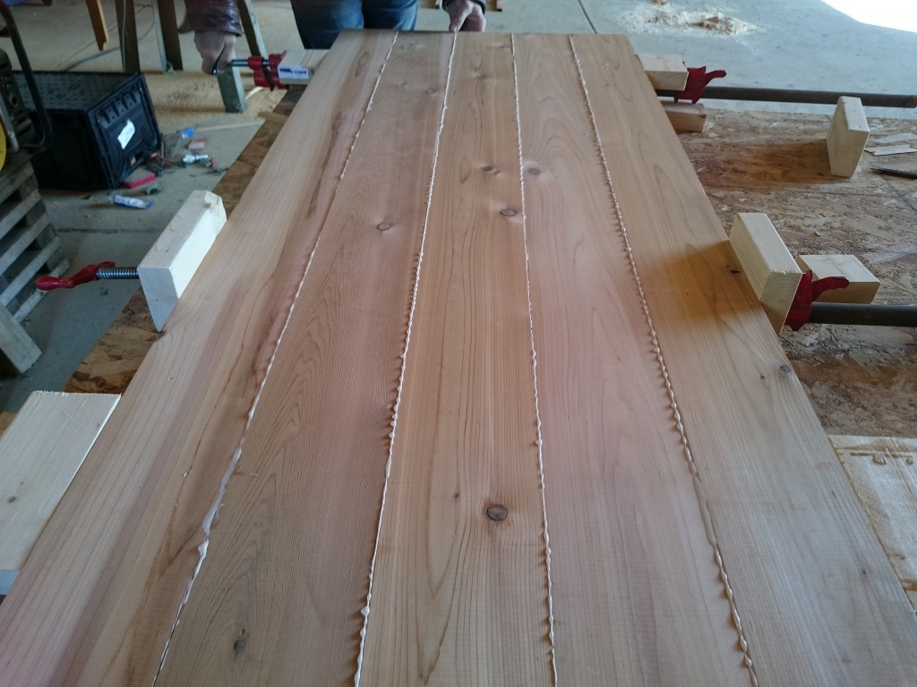 All the boards for the table top clamped together.