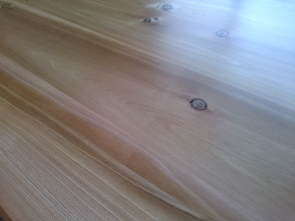 Close up shot of the polyurethane finish on the table top.